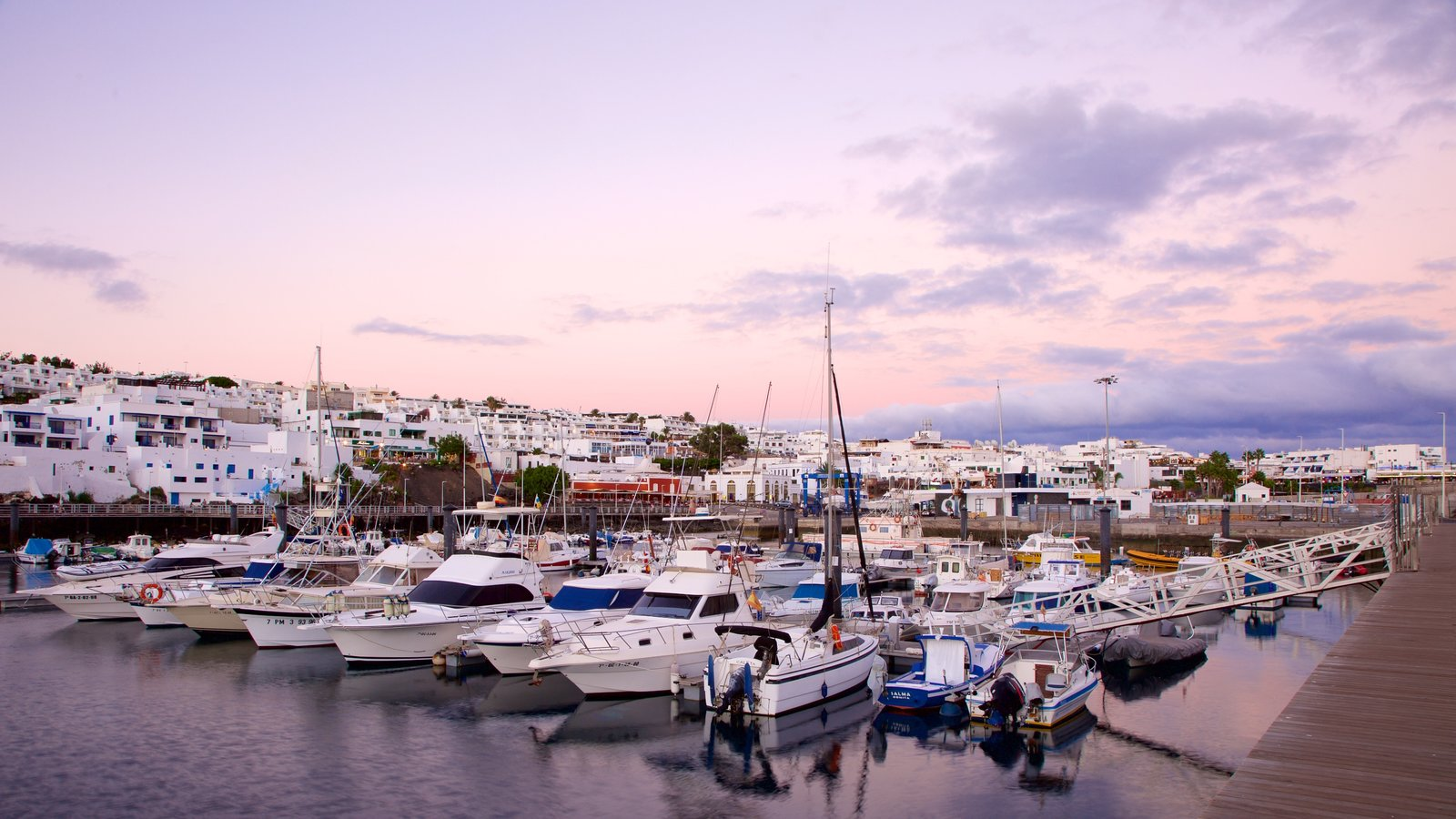 Puerto del Carmen featuring a bay or harbor, a coastal town and boating