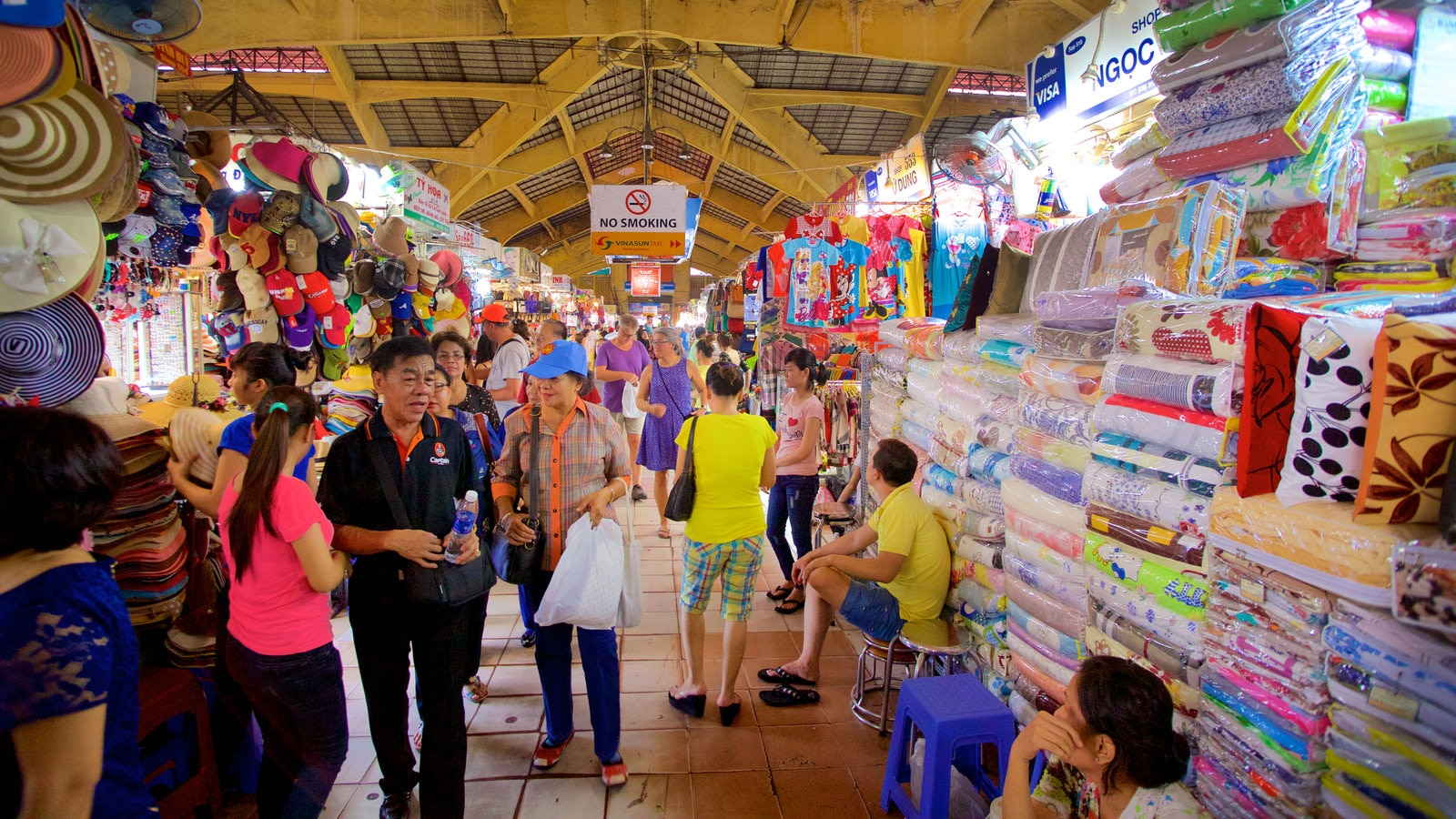 Ben Thanh Market which includes interior views, shopping and markets