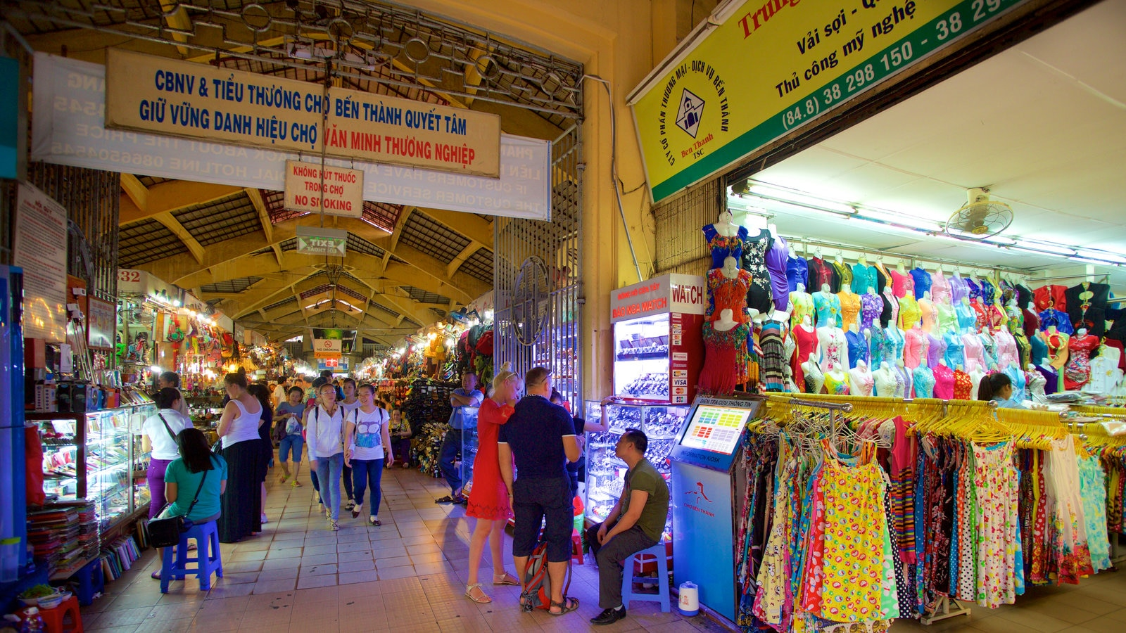 Ben Thanh Market featuring interior views, shopping and markets