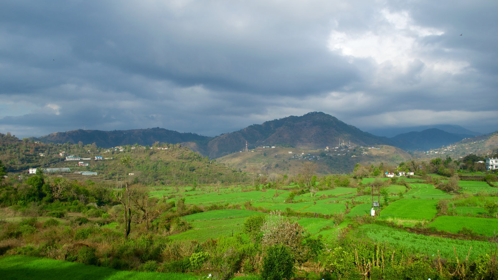 Uttarakhand which includes farmland, tranquil scenes and mountains