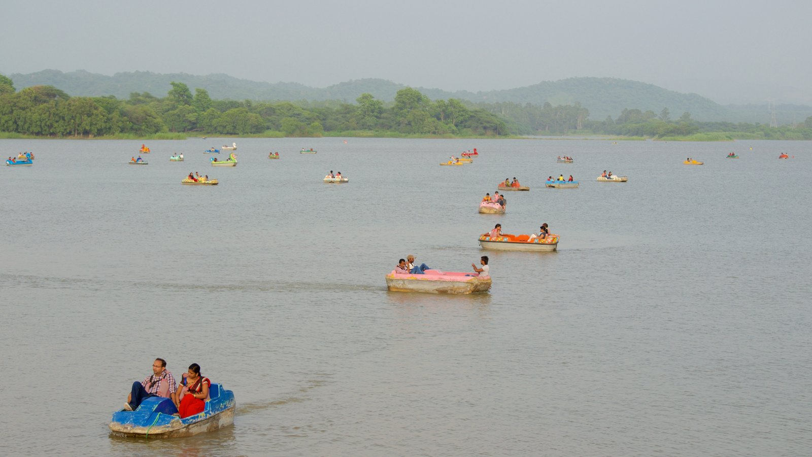 Sukhna Lake showing a lake or waterhole and kayaking or canoeing as well as a small group of people