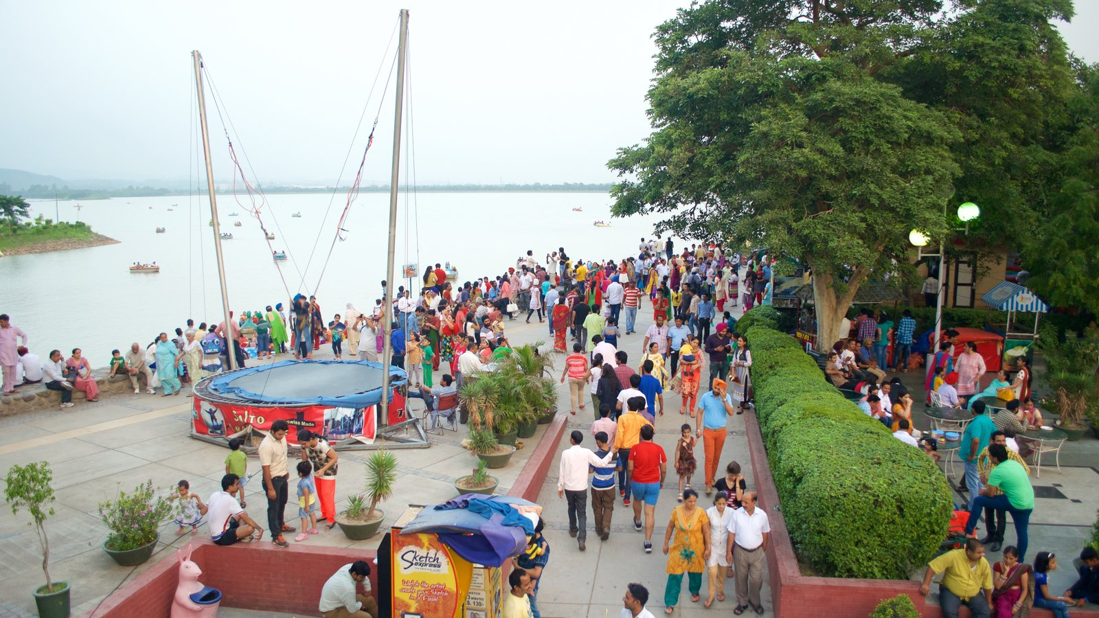 Sukhna Lake showing a lake or waterhole as well as a large group of people