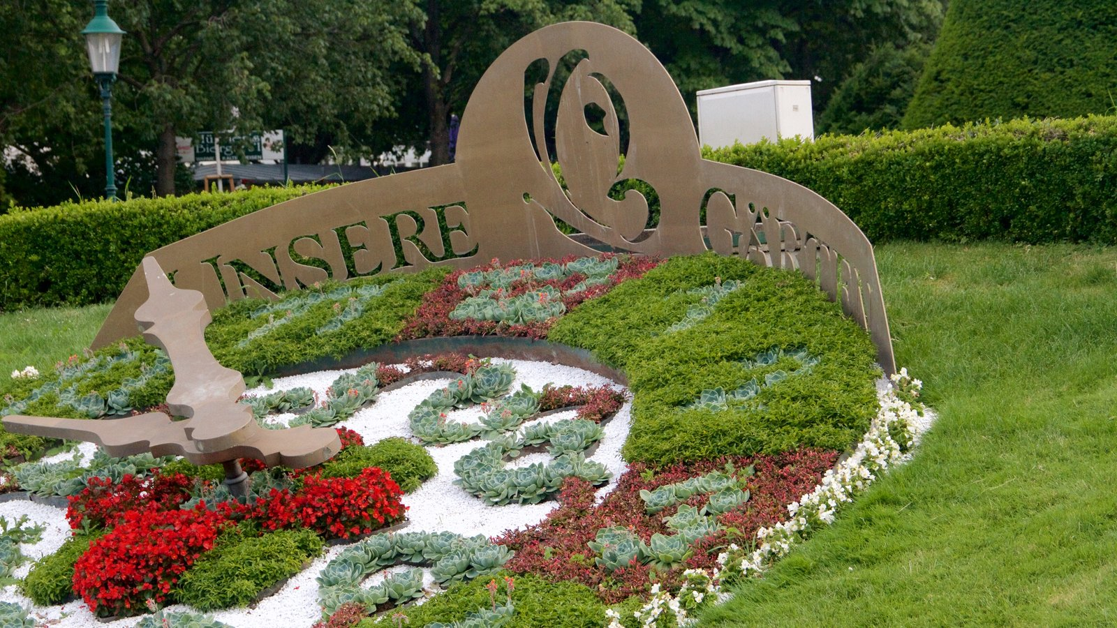 Viennese City Park Featuring A Garden, Flowers And Signage
