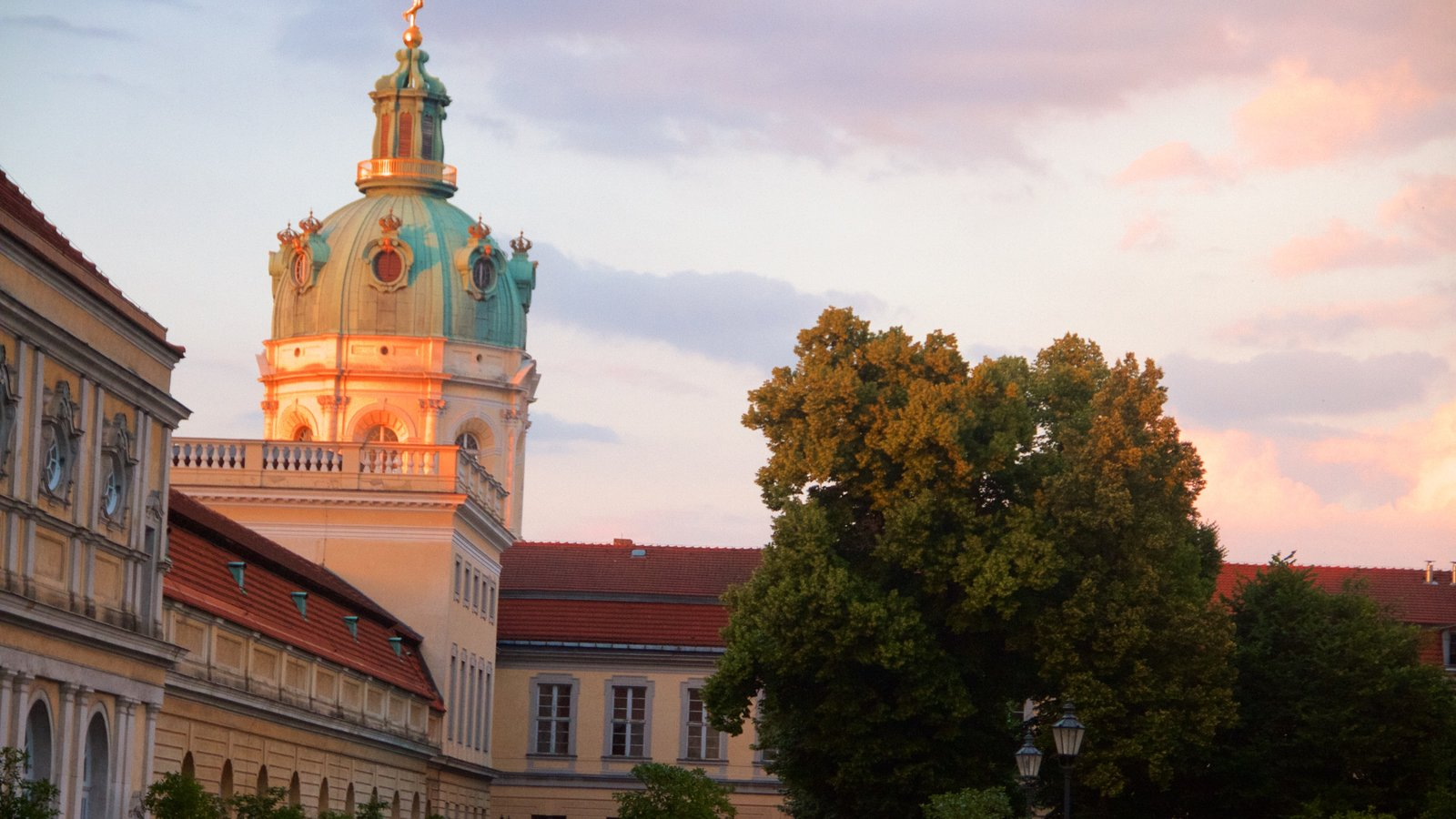 Schloss Charlottenburg which includes a sunset, heritage elements and heritage architecture