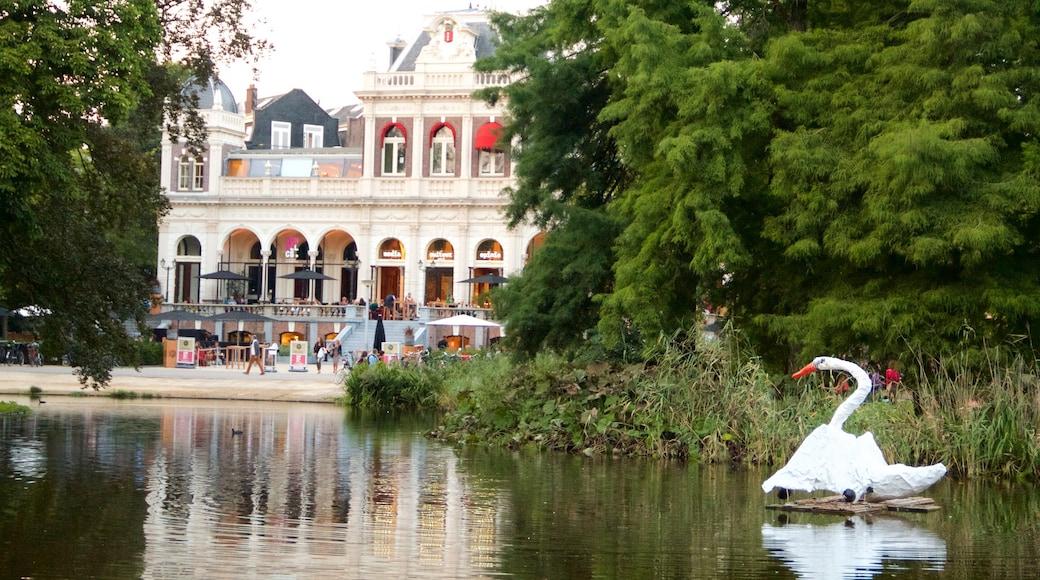 Amsterdam welches beinhaltet Teich, Vögel und historische Architektur