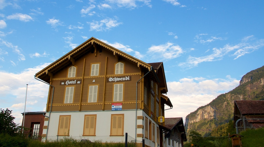 Bernese Alps showing signage and a house