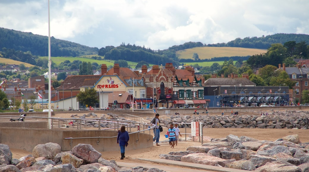 Minehead which includes a beach and a coastal town as well as a small group of people