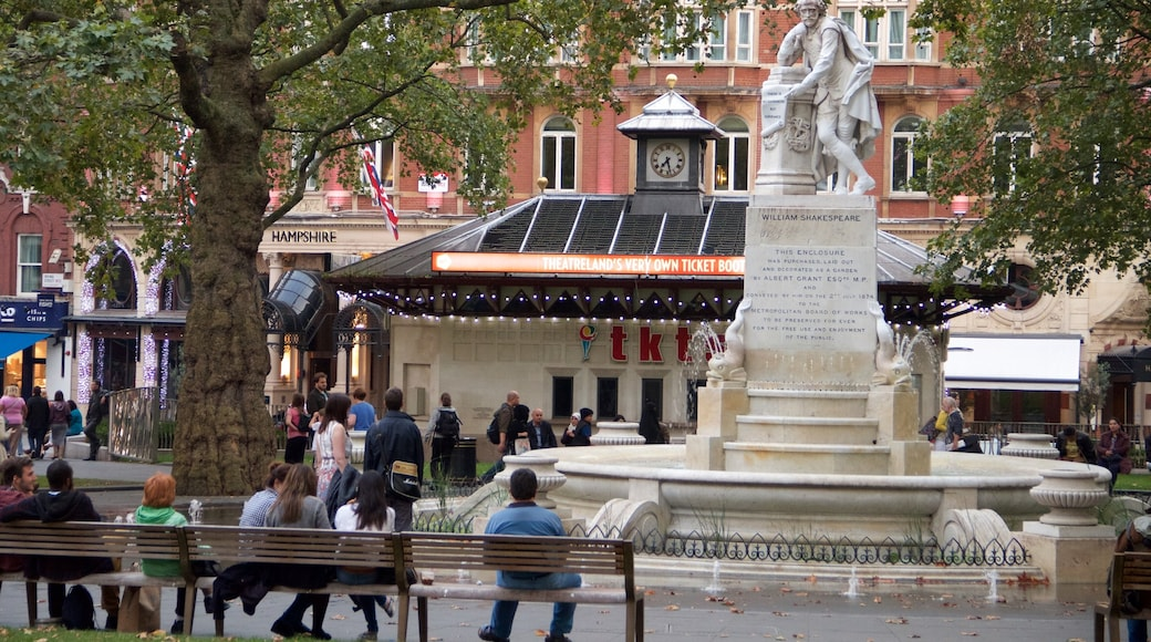 Leicester Square which includes a square or plaza and a fountain