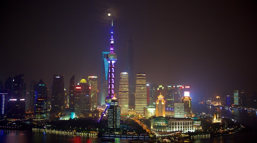 Oriental Pearl Tower which includes night scenes, skyline and a city