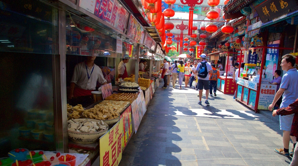 Wangfujing Street featuring markets as well as a small group of people