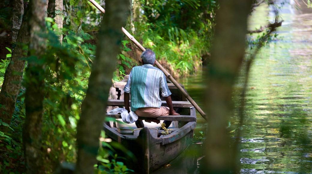 Kumarakom Bird Sanctuary featuring a river or creek as well as an individual male