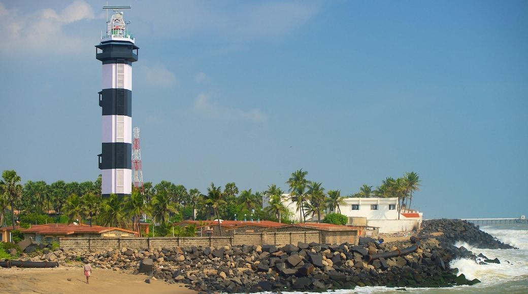 Pondicherry Lighthouse featuring a lighthouse, rocky coastline and a sandy beach