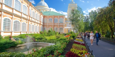 Alexander Nevsky Lavra featuring a park and heritage architecture as well as a small group of people