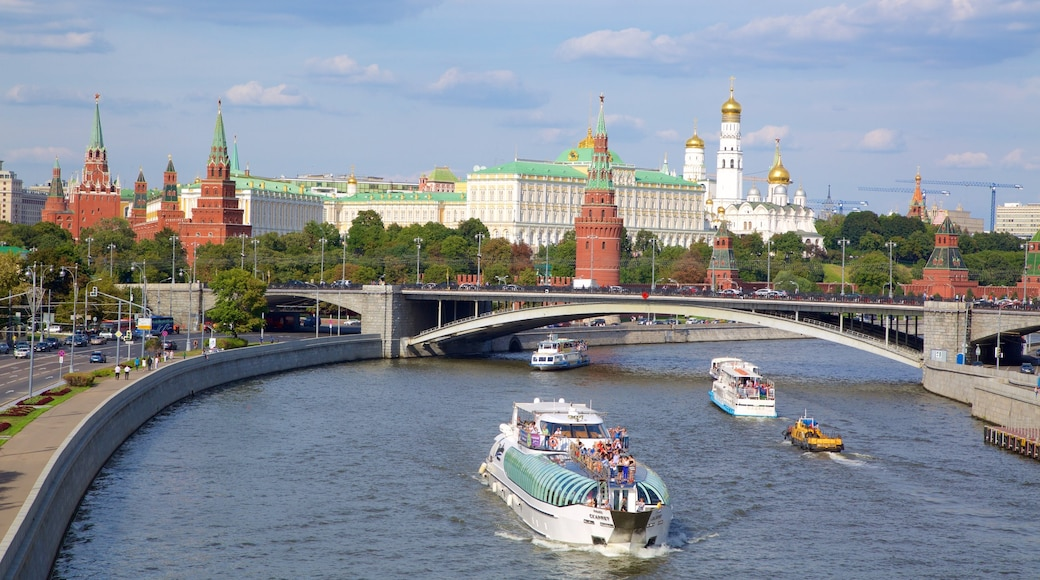 Moscow Kremlin showing a ferry, a bridge and a river or creek