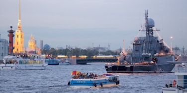 Peter and Paul Fortress showing a ferry and a river or creek