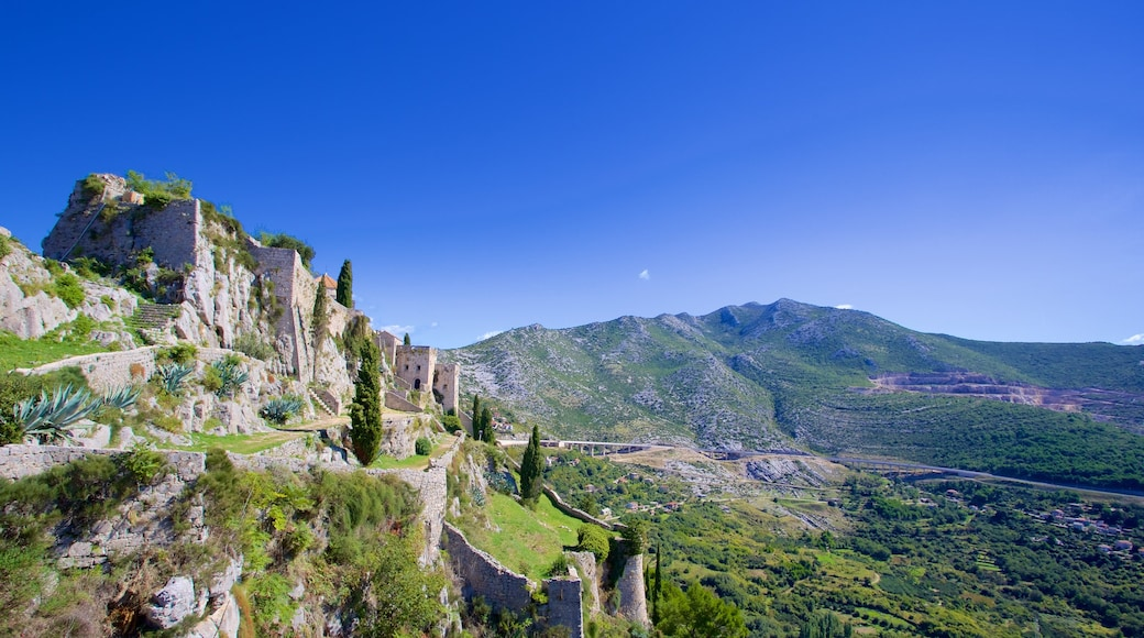 Klis Fortress which includes building ruins, heritage elements and mountains