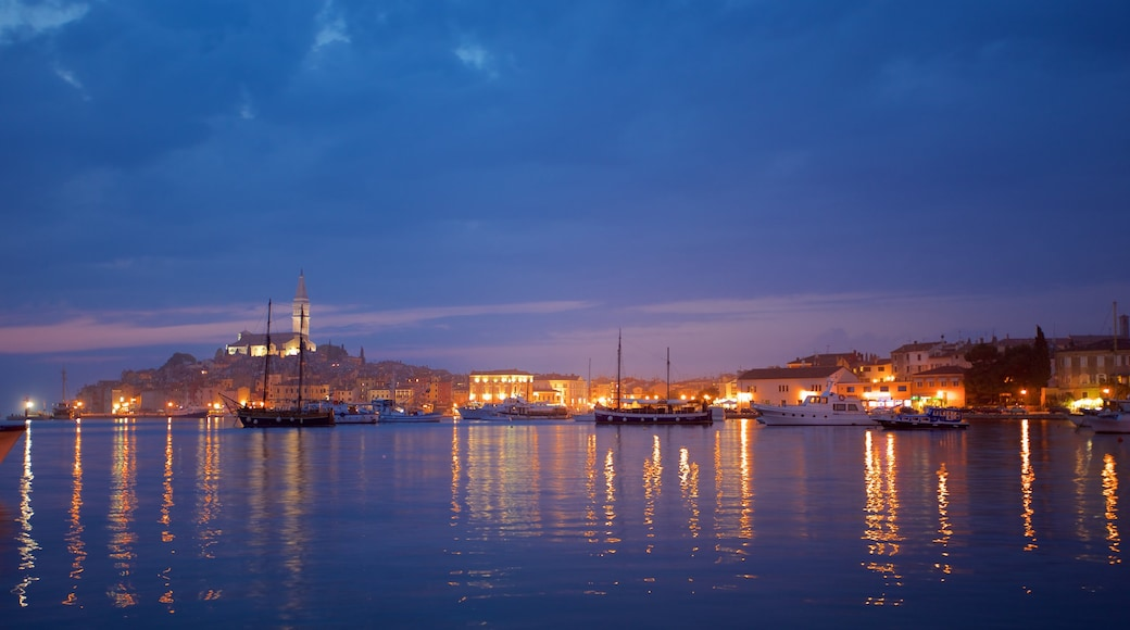 Rovinj Harbour featuring night scenes and a bay or harbor