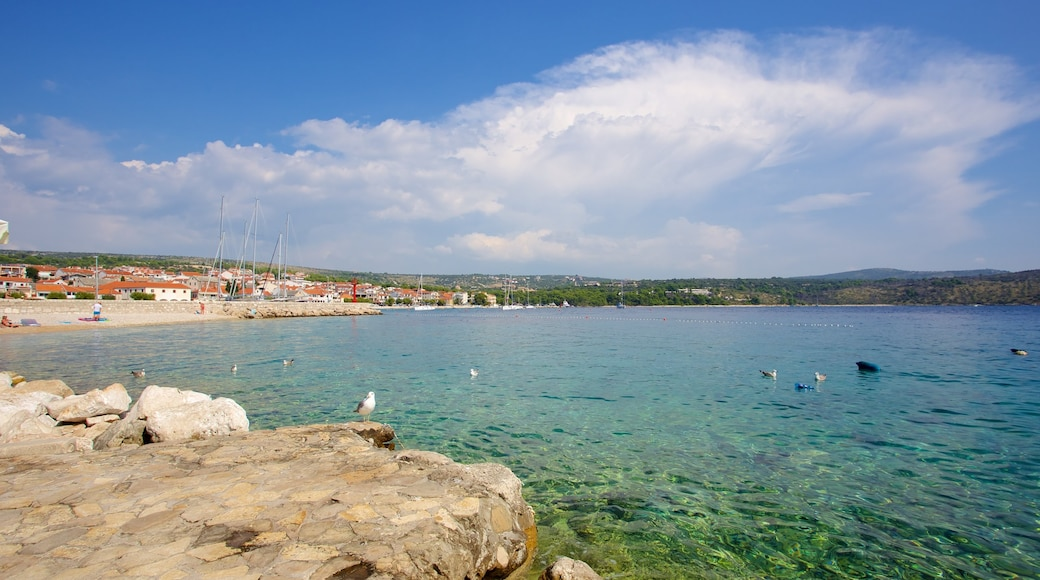 Primosten Beach showing a coastal town and rocky coastline
