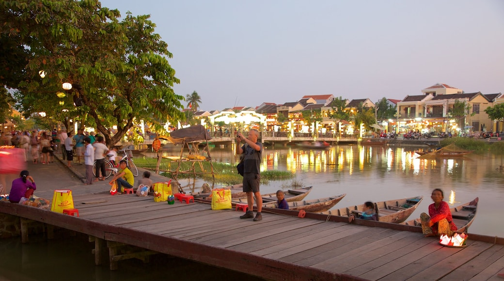 Hoi An Ancient Town showing a bay or harbour, night scenes and a small town or village