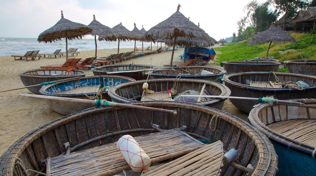 Hoi An featuring tropical scenes, boating and a beach
