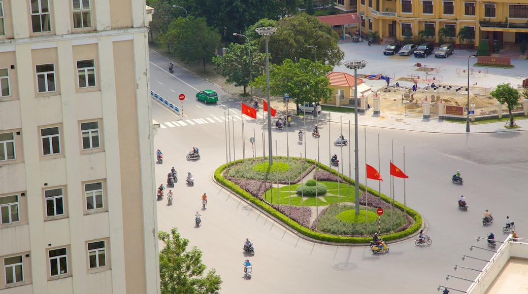 Hue City Centre which includes motorbike riding, a city and street scenes