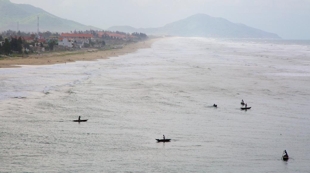Lang Co featuring mist or fog, a sandy beach and a coastal town