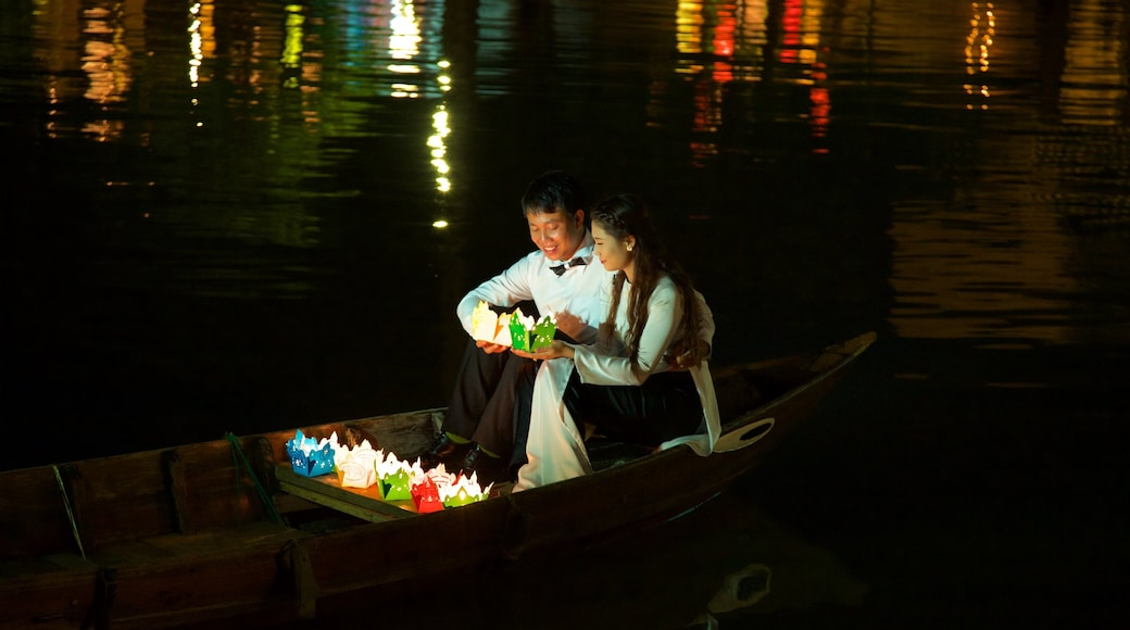 Hoi An showing night scenes and kayaking or canoeing as well as a couple