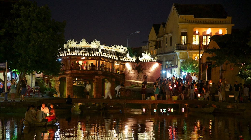 Hoi An featuring a river or creek, night scenes and kayaking or canoeing