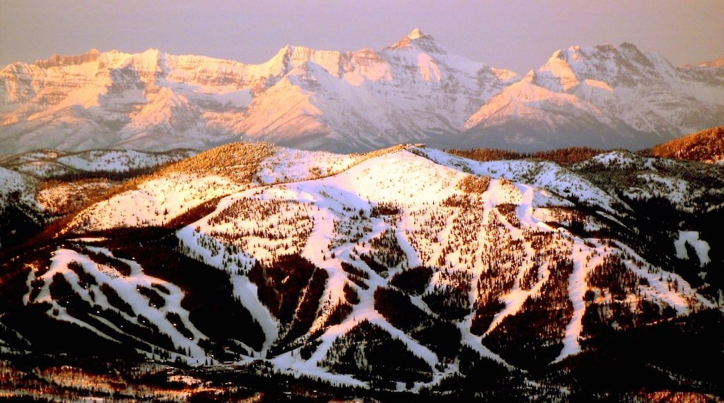Montana which includes snow, mountains and a sunset