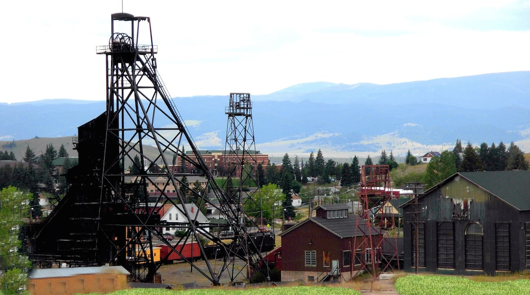Butte featuring industrial elements, a small town or village and mountains