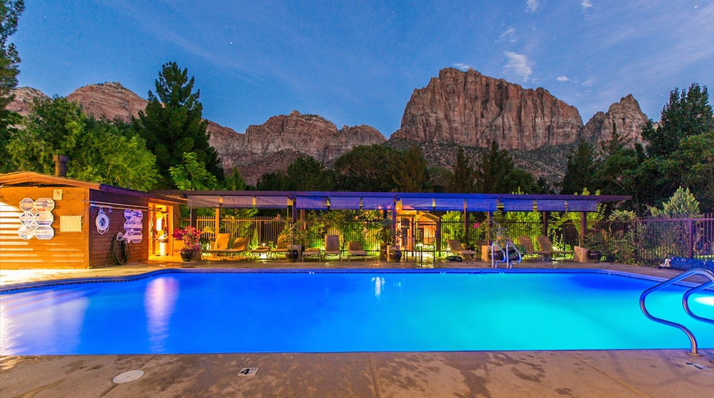 Springdale which includes a pool, night scenes and a gorge or canyon