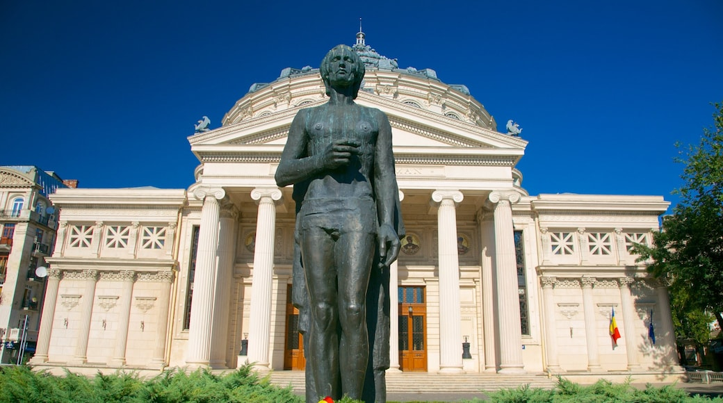 Romanian Athenaeum showing heritage architecture, a statue or sculpture and theatre scenes