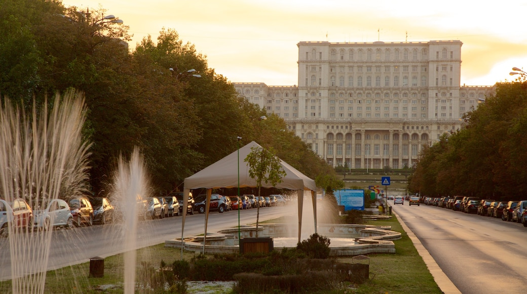 Palace of the Parliament featuring a sunset, a fountain and heritage architecture