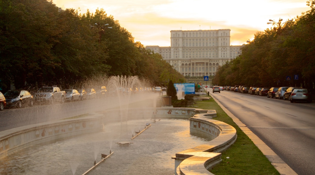 Palace of the Parliament featuring a fountain, street scenes and heritage architecture