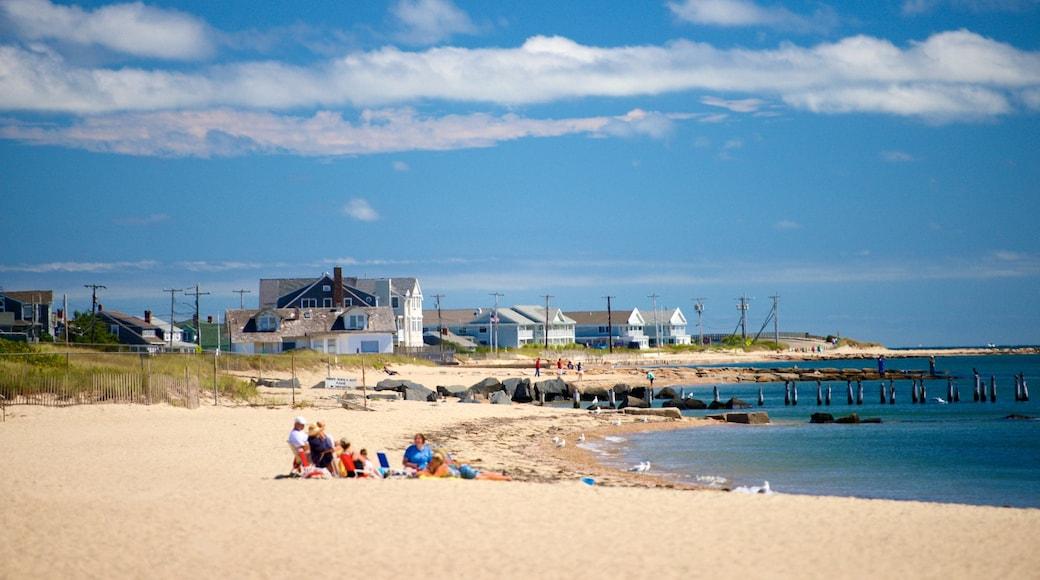 Surf Drive Beach featuring a beach and a coastal town as well as a family
