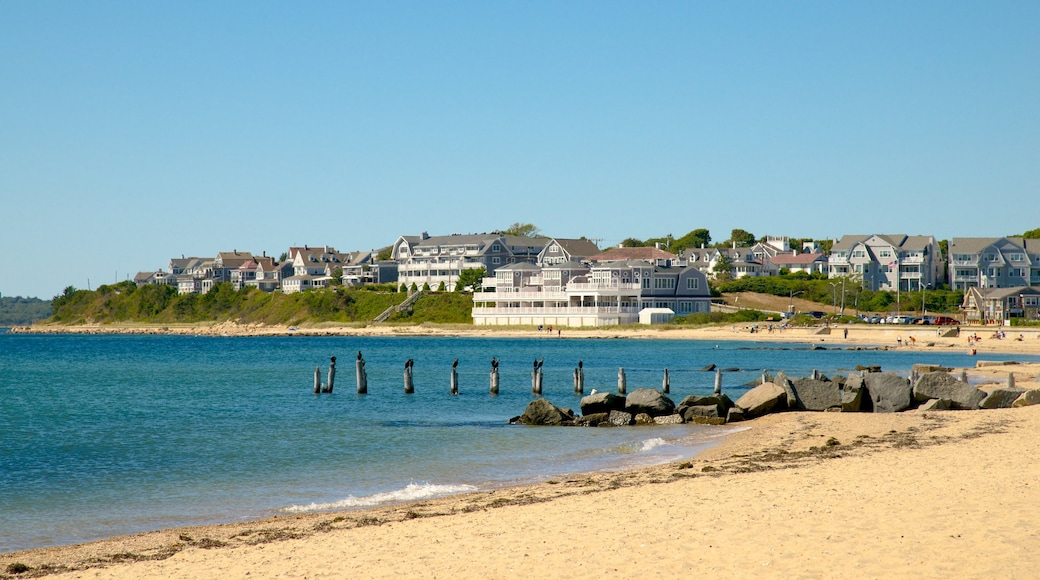 Surf Drive Beach which includes a sandy beach and a coastal town