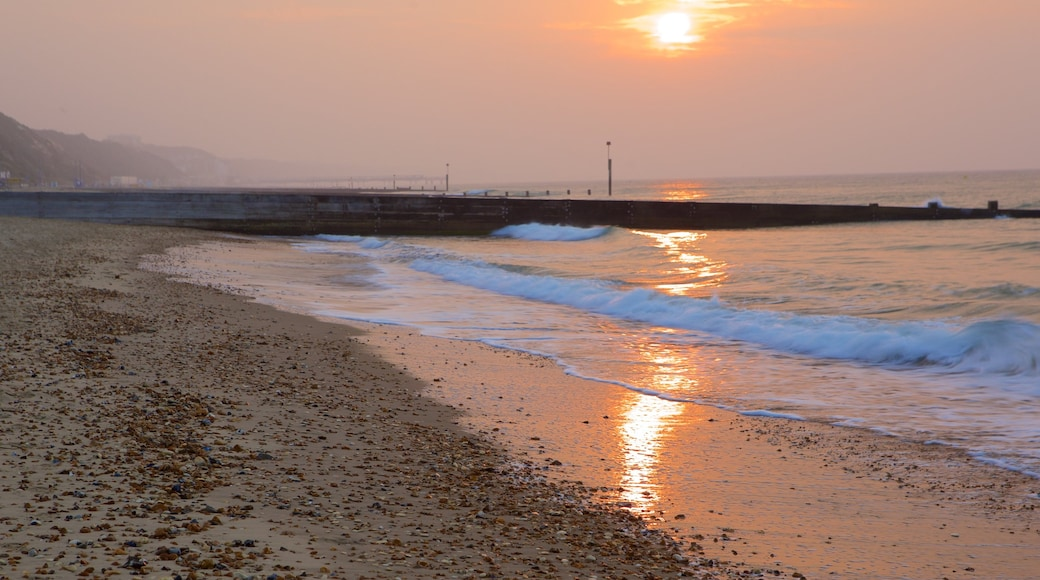 Bournemouth Beach which includes a sunset and a pebble beach