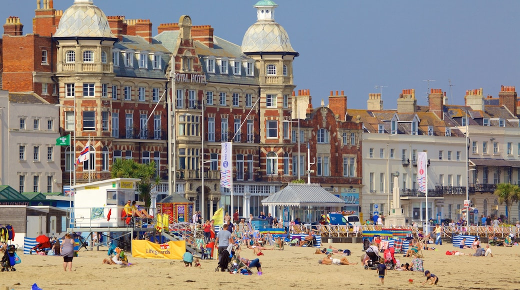Weymouth Beach featuring a beach as well as a large group of people