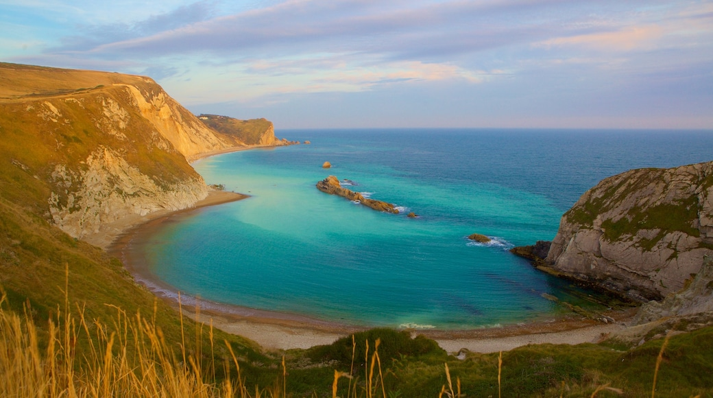 Durdle Door featuring a bay or harbour and rugged coastline