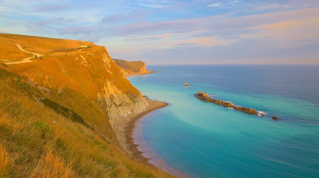Durdle Door showing tranquil scenes, a bay or harbour and general coastal views