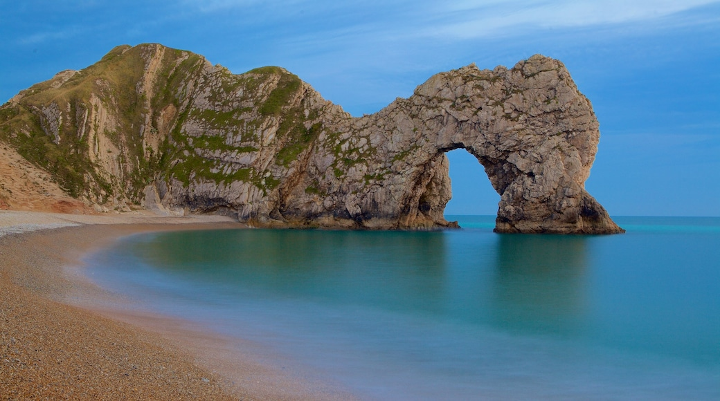 Durdle Door which includes a pebble beach and rugged coastline