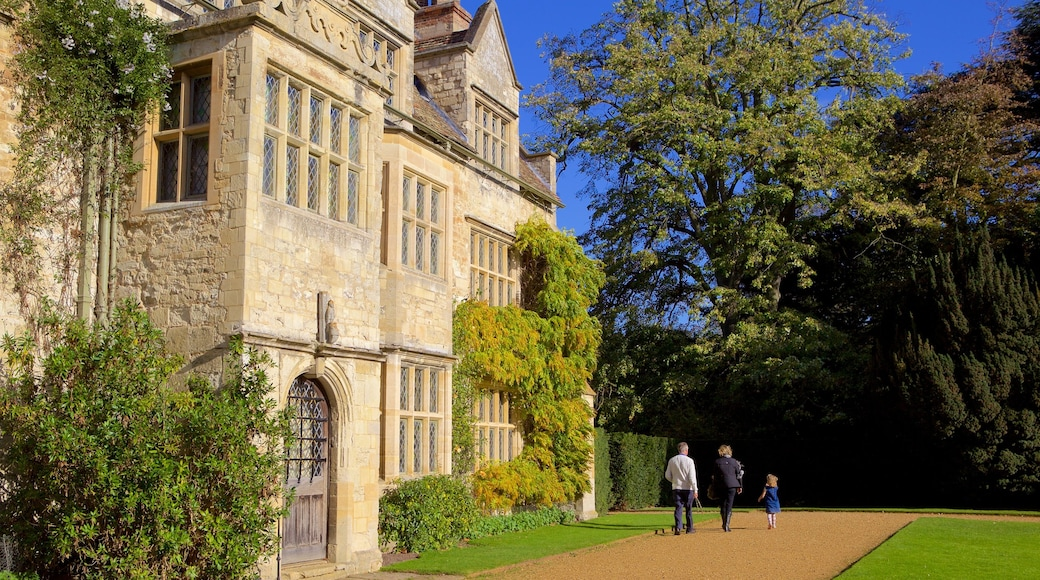 Anglesey Abbey showing heritage elements and heritage architecture as well as a family