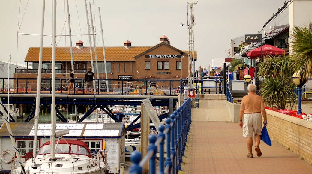 Brighton Marina showing a marina as well as an individual male