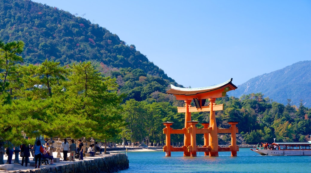 Itsukushima Shrine which includes mountains and heritage elements