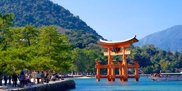 Itsukushima Shrine showing mountains and heritage elements