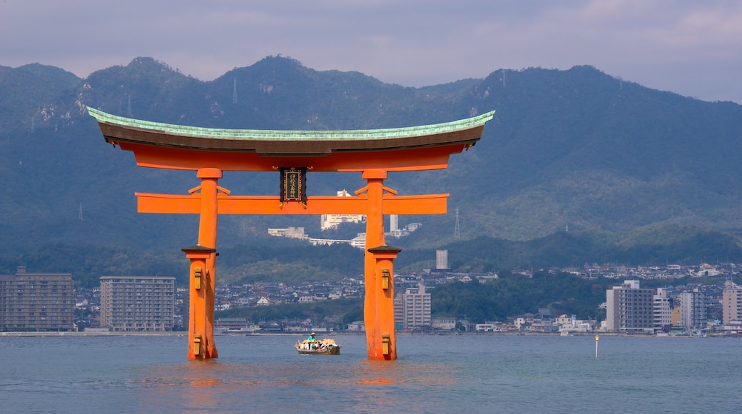 Itsukushima Shrine which includes heritage elements and a lake or waterhole