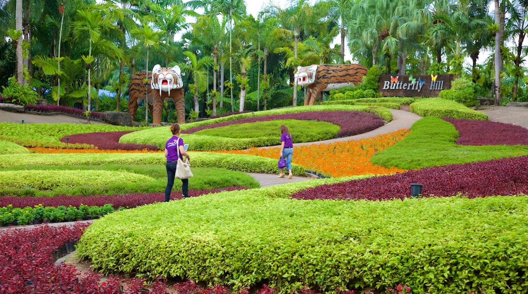 Nong Nooch Tropical Botanical Garden showing a park as well as a small group of people