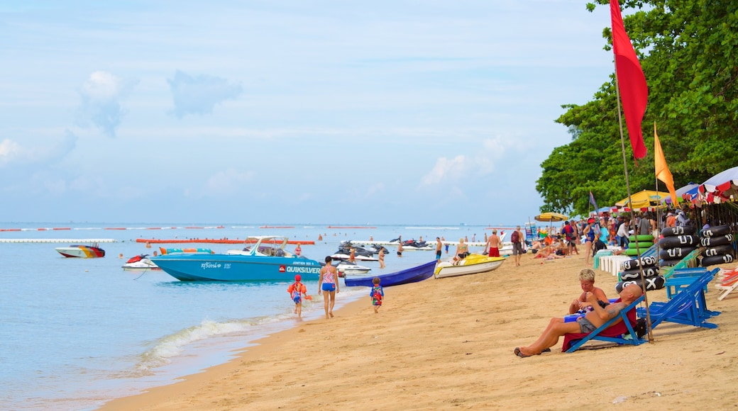 Jomtien Beach which includes a sandy beach as well as a large group of people