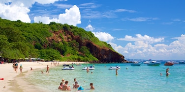 Nual Beach which includes swimming and a bay or harbor as well as a large group of people
