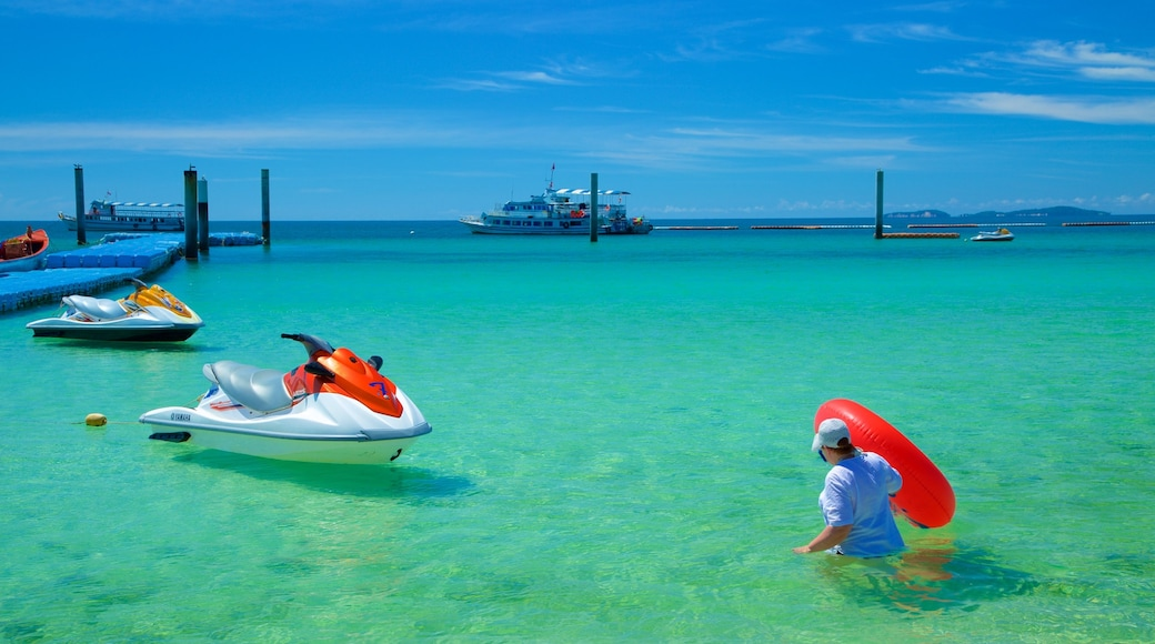 Samae Beach which includes jet skiing and general coastal views as well as an individual female